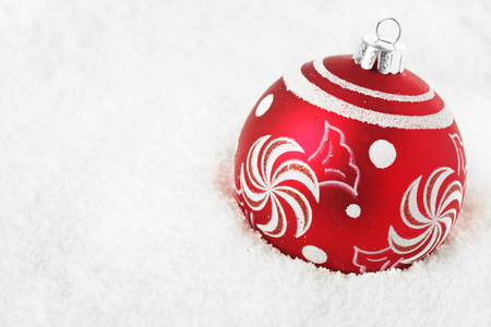 Red Christmas decoration in snow