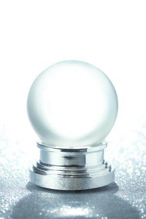 snowdome: Empty snow globe on glittering background