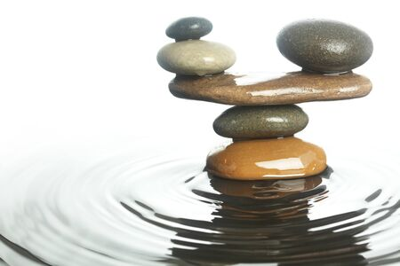 Carefully balanced stones in water Banco de Imagens