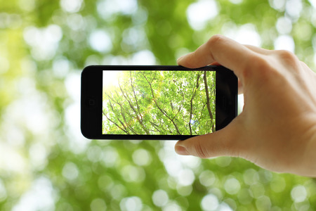 Taking a picture with a smart phone Stock Photo