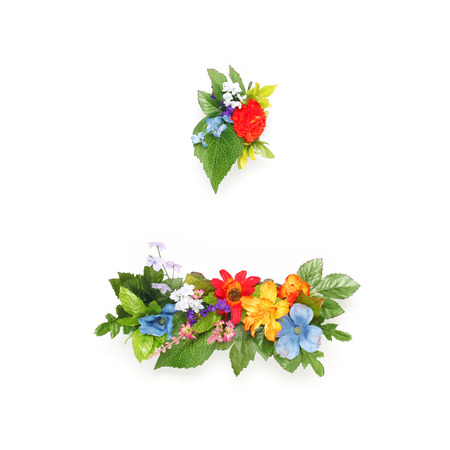 Period and dash made of leaves and flowers photo