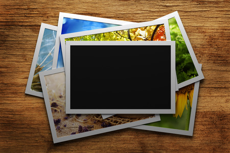 photo album: Pile of colorful photos with blank frame