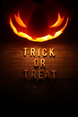 Spooky Halloween background with jack o lantern - Trick or Treat photo