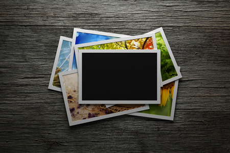 Pile of colorful photos with blank frame photo