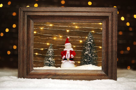 picture frame: Peaceful winter scene with snowman Stock Photo