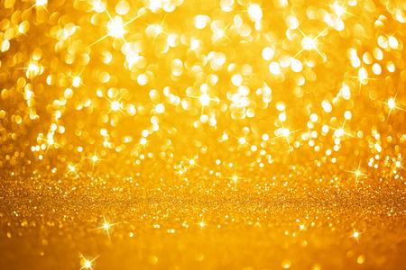 polvo: Las luces de fondo de oro Foto de archivo
