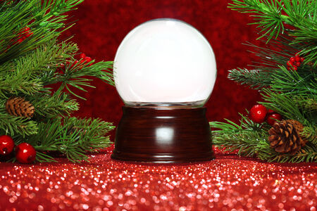 Christmas tree branches with empty snowglobe photo