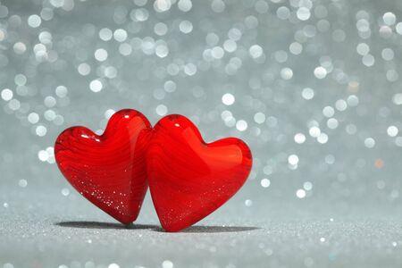 two hearts: Shiny red hearts background Stock Photo