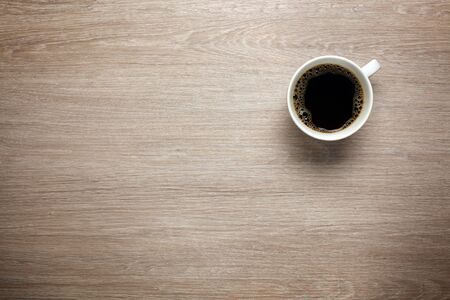 Cup of coffee on desk photo