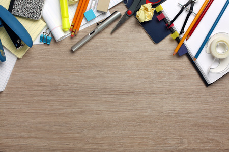 cluttered: Desk cluttered with office supplies Stock Photo