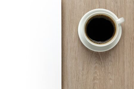office space: Cup of coffee on office desk with white space Stock Photo