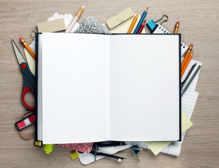 school things: Open book with office supplies