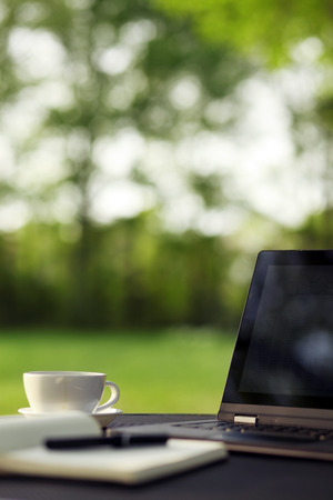 coffee table: Laptop and coffee, outdoor office