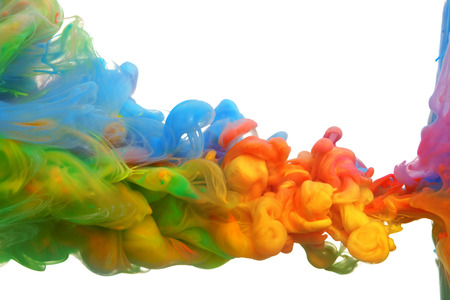 Clouds of bright colorful ink mixing in water Imagens