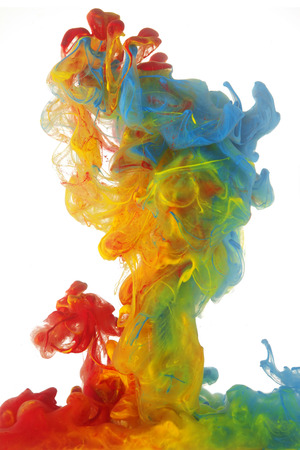 Clouds of bright colorful ink mixing in water Stock Photo