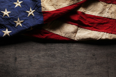white day: Old and worn American flag for Memorial Day or 4th of July Stock Photo