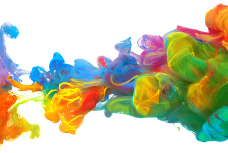 Clouds of bright colorful ink mixing in water 写真素材