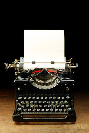 old fashioned: Old vintage typewriter with blank paper
