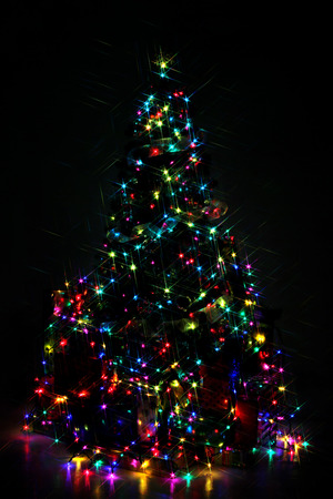 decorated christmas tree lit up with colorful lights at night stock photo 48220056