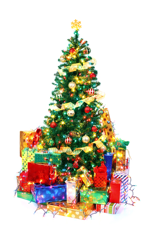 christmas lights background: Decorated Christmas tree surrounded by colorful presents. Isolated on white.