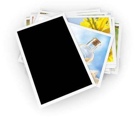 Pila di foto con la foto in bianco sulla parte superiore Archivio Fotografico - 64515443