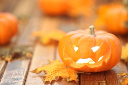 wood carvings: Halloween jack o lantern background Stock Photo