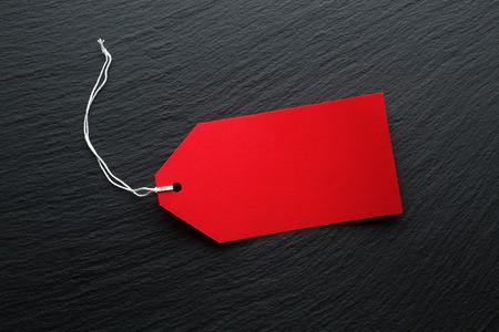 blank tag: Blank price tags on dark background