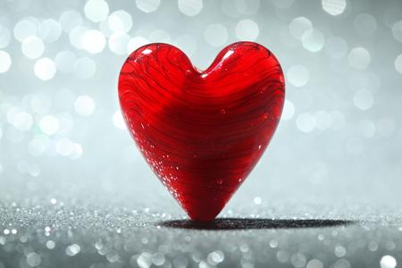 Glanzend rood hart achtergrond Stockfoto