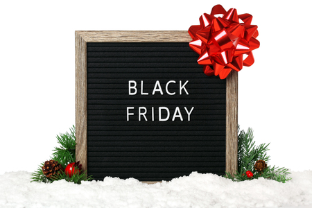 Felt board decorated with Christmas bow and ribbon - Black Friday Archivio Fotografico