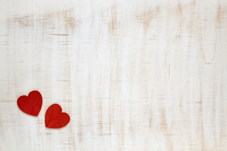 Red Valentines Day hearts on wooden background