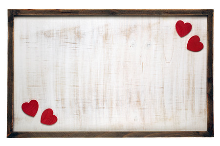 Red Valentines Day hearts on wooden frame background
