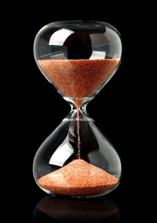 Hourglass with red sand showing the passage of time Stok Fotoğraf
