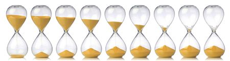Collection of hourglasses with yellow sand showing the passage of time Stock Photo