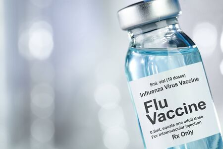 Small drug vial with influenza vaccine Stock Photo