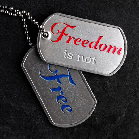 Old and worn military dog tags - Freedom is not Free
