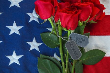 American flag with roses and military dog tags with text - Thank You Veterans