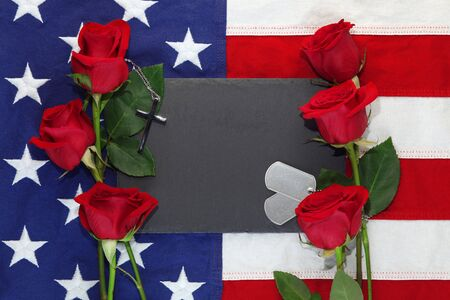 American flag with roses, military dog tags, and a cross