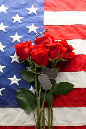 American flag with roses and blank military dog tags 写真素材