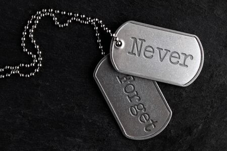 Old and worn military dog tags - Never Forget 写真素材