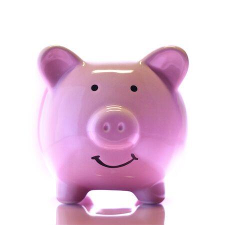 Smiling Piggybank isolated on white. Saving money concept.