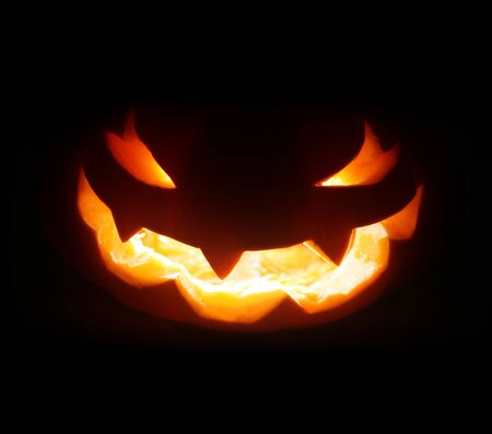 Spooky Halloween jack o lantern face glowing in the dark Stock fotó