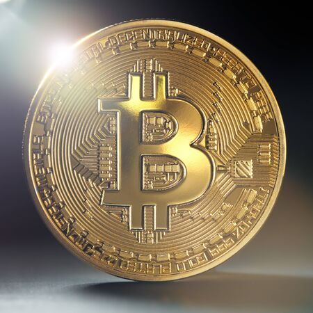 Close up of a single golden bitcoin coin in shining light.  Wealth, digital, virtual, currency, and cryptocurrency concept.