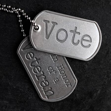 Old and worn military dog tags - Vote in Honor of a Veteran Stock fotó