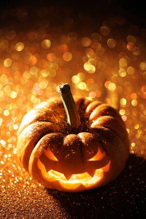 Glowing Jack-o-Lantern on sparkly orange background