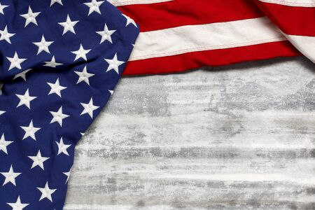 US American flag on worn white wooden background. For USA Memorial day, Veterans day, Labor day, or 4th of July celebration. With blank space for text.