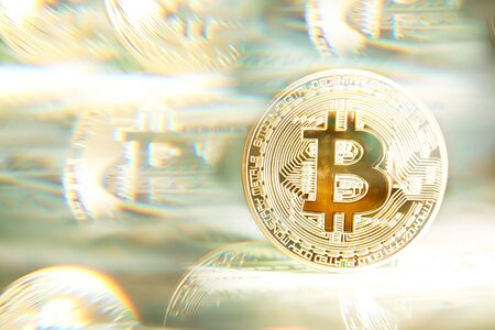 Shiny bright golden bitcoin, balanced on piles of money. Wealth, digital, virtual, currency, and cryptocurrency concept. Stock fotó