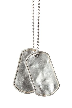 Old and worn blank military dog tags with chain isolated on white
