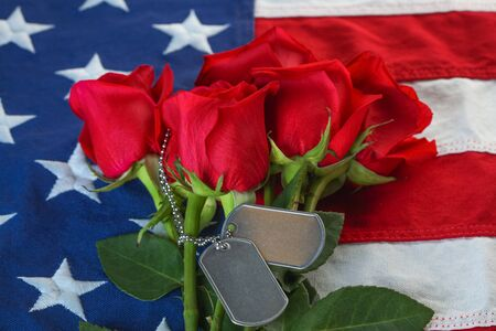 American flag with roses and blank military dog tags 版權商用圖片
