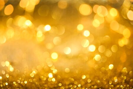 Abstract bokeh of sparkling gold glitter background or wallpaper 版權商用圖片
