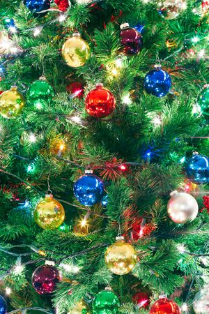 Close up of a decorated Christmas tree with lights and ornaments
